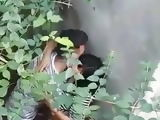 indian teen couple enjoying behind the wall