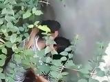 indian teen couple enjoying behind the wall
